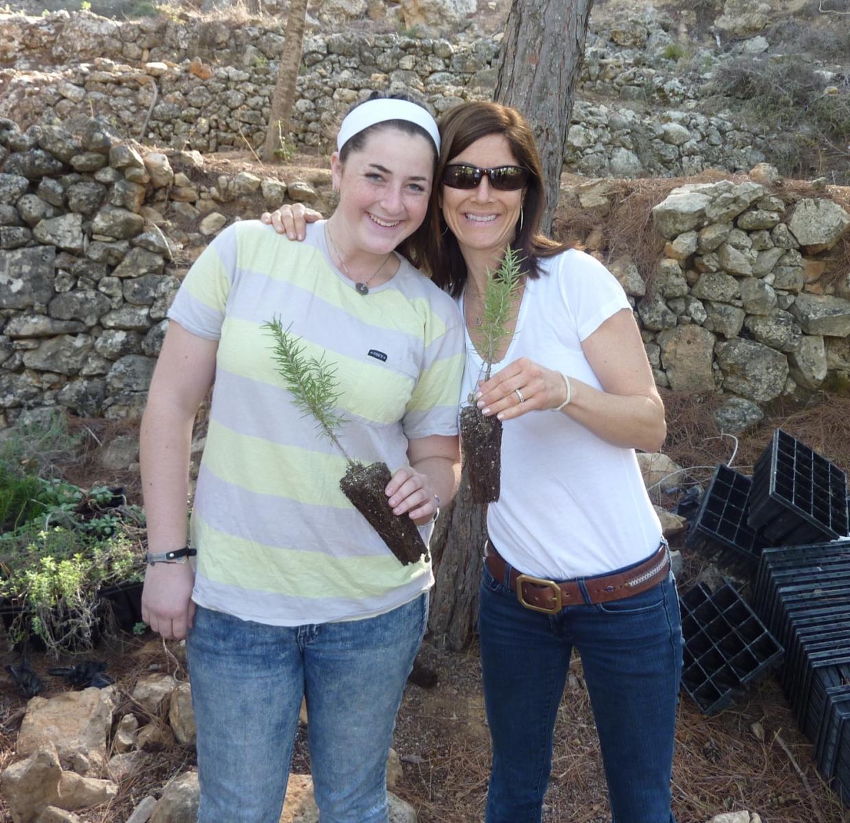 Jenna and Beth Freeman planting trees for JNF