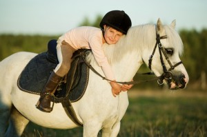 girl-riding-a-horse-000043963532_large